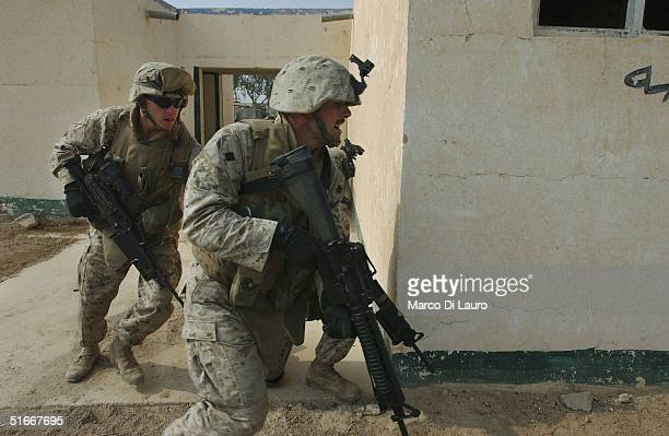 Marines from the 1st Expeditionary Force 1st Battalion 3rd Marines train for urban combat as they prepare for a possible offensive on Falluja on...