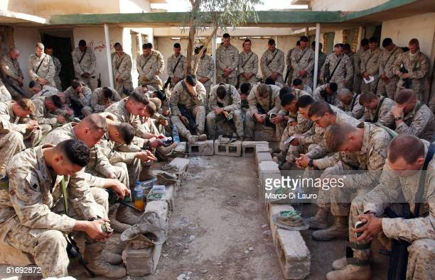 Marines from the 1st Expeditionary Force 1st Battalion pray at a protestant religious sevice anticipating the final offensive on Fallujah on November...