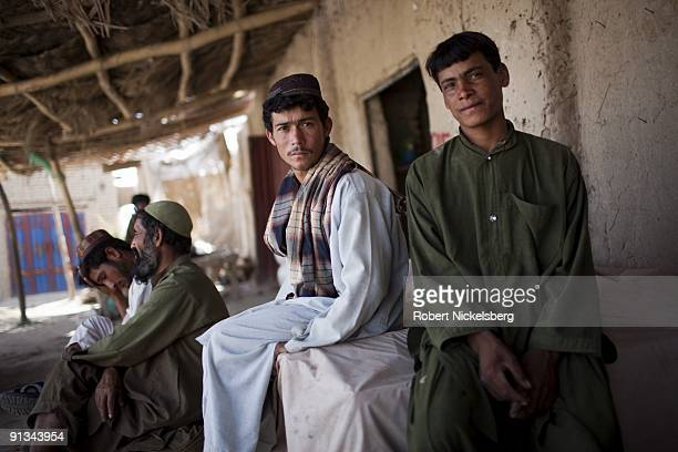 Marines from the 1st Marine Division 2nd Light Armored Reconnaissance battalion speak with afghans at the local bazaar in Khan Neshin Helmand...