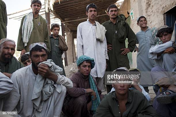 Marines from the 1st Marine Division 2nd Light Armored Reconnaissance Battalion speak with afghans at the local bazaar August 13 2009 in Khan Neshin...