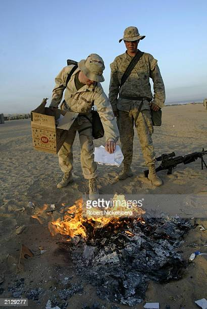 Marines from the 1st Marine Division based 45 km south of the Iraqi border burn personal letters, before they move toward the forward deployment zone...