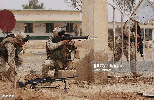 Marines from the 1st Marine Expeditionary Force conduct urban warfare training as they prepare for an expected allout military offensive against...