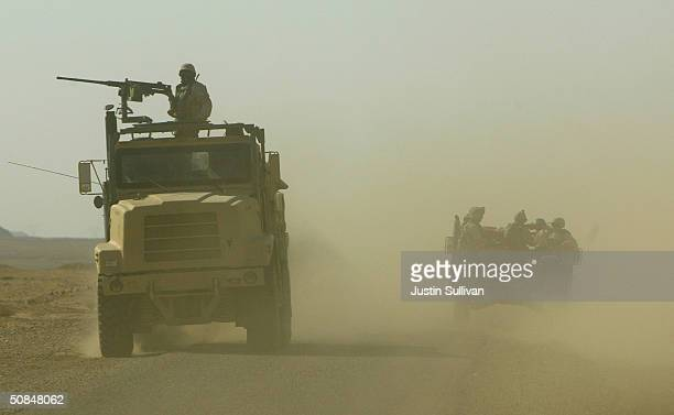 S Marines from the 1st platoon Golf Company 2nd Battalion 7th Marines 1st Marinies Division drive in a convoy while on patrol May 17 2004 in Al Furat...
