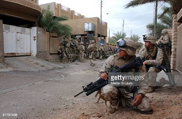 S Marines from the 1st US Marines Expeditionary Force 1st Battalion 3rd Marines Regiment Bravo Company patrol the street during an offensive November...