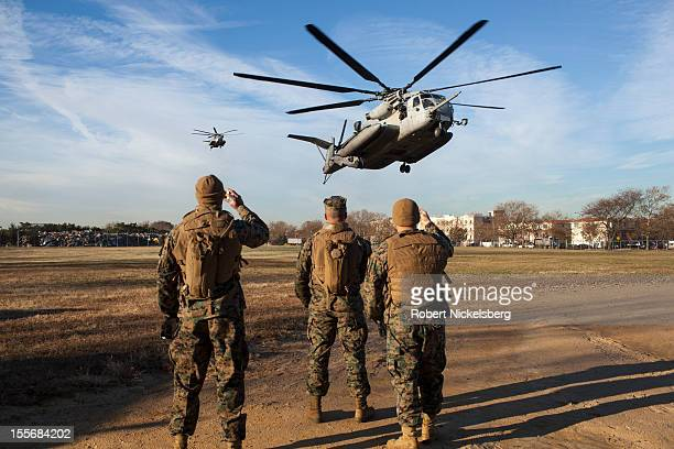 S Marines from the 26th Marine Expeditionary Unit and US Navy seamen from the USS Wasp land in a CH53 helicopter on a field November 6 2012 in the...