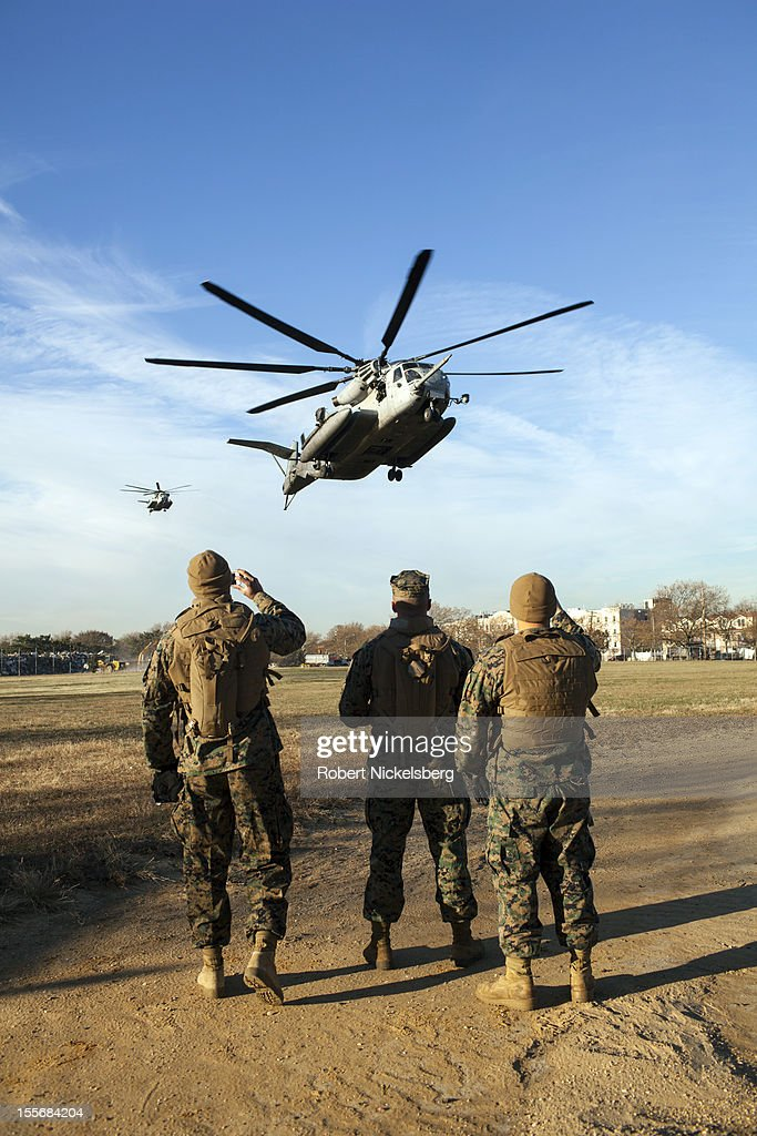 U.S. Marines from the 26th Marine Expeditionary Unit and U.S. Navy seamen from the U.S.S. Wasp land in a CH-53 helicopter on a field November 6, 2012 in the Midland Beach area of the Staten Island borough of New York. The Marines and Navy seamen are assisting local residents removing household items damaged by Superstorm Sandy.