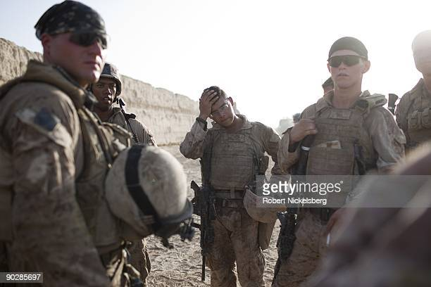 Marines from the 2nd Marine Division 2nd Light Armored Reconnaissance Battalion Delta Company hold a briefing after carrying out a security patrol of...