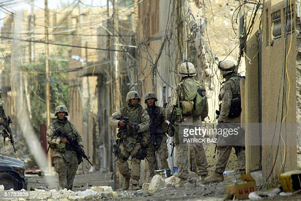 US marines from the 3/5 Lima company conduct a housetohouse search in Jolan district of the restive city of Fallujah 12 November 2004 50 kms west of...