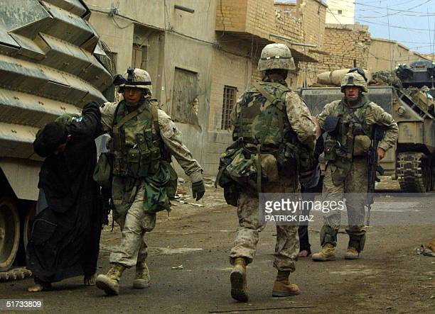 US marines from the 3/5 Lima company lead away a suspected insurgents captured in the Jolan district of the restive city of Fallujah 12 November 2004...