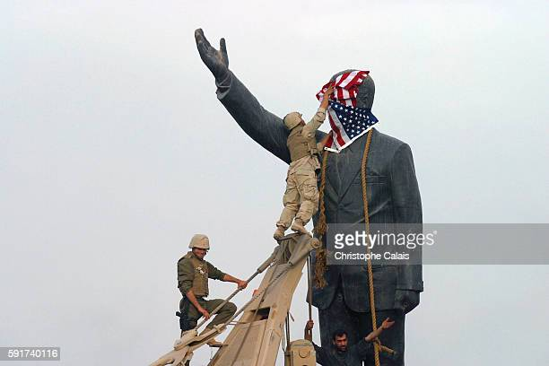 US Marines from the 3rd Batallion 4th Regiment are the first American troops to reach the center of Baghdad They're the first to take down a statue...