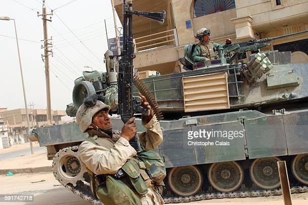 US Marines from the 3rd Batallion 4th Regiment are the first American troops to reach the center of Baghdad