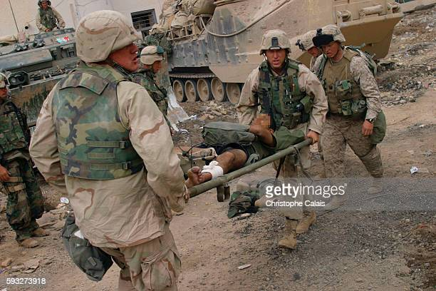 US Marines from the 3rd batallion 4th regiment cross the Tigris river and enter the city of Baghdad Marines tend to a soldier wounded in action