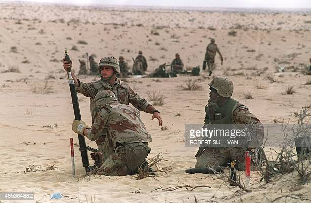 US Marines from the 3rd Battilion 6th Marines fire a 60mm mortar during a live fire exercise 11 january 1991 in the desert of Saudi Arabia as part of...