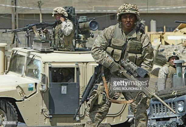 Marines from the1st Marine Expeditionary Force move into Fallujah 07 April 2004 AFP PHOTO/Cris BOURONCLE