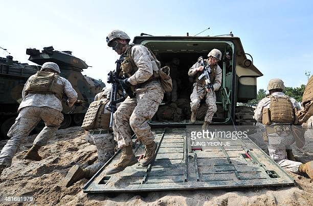 US Marines get out from an amphibious assault vehicle during a joint landing operation by US and South Korean Marines in Pohang 270 kms southeast of...
