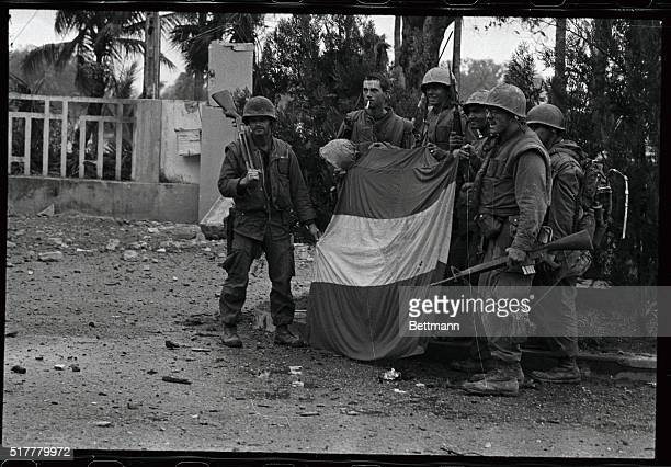 US Marines hold a Viet Cong flag they ripped down from atop the Thua Thien Province headquarters and then replaced it with the stars and stripes The...