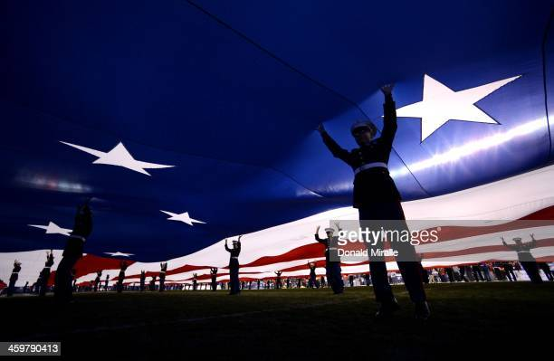 S Marines hold up the American flag before the game against the Arizona State Sun Devils and Texas Tech Red Raiders in the National University...