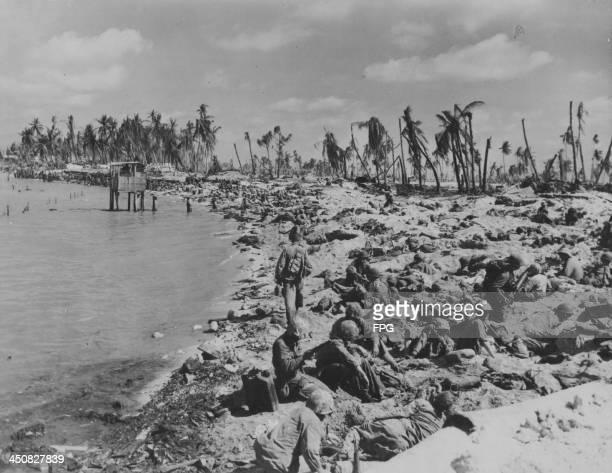 US marines huddled on the beaches during the Battle of Tarawa in World War Two Kiribati November 1943
