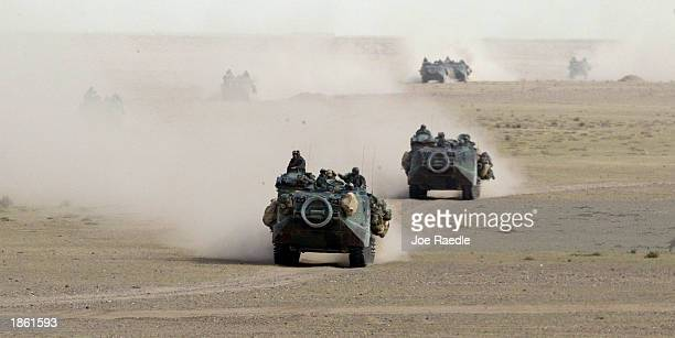 S Marines in armored attack vehicles from Task Force Tarawa roll through the Iraqi countryside March 21 2003 on their way to an objective in Iraq US...