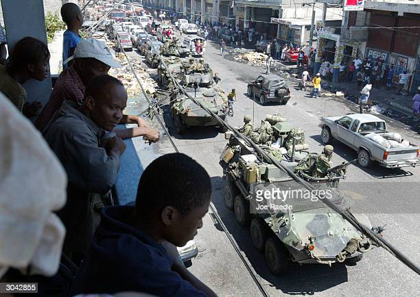 S Marines in Light Armored Vehicle drive through the streets during a patrol March 4 2004 in PortauPrince Haiti The 2000 US Marines and other...