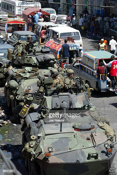 S Marines in Light Armored Vehicles drive through the streets during a patrol March 4 2004 in PortauPrince Haiti The 2000 US Marines and other...