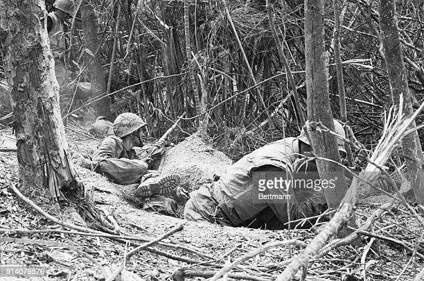 Marines in shallow foxholes fire at enemy troops in Dong Ha Vietnam