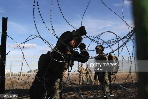 S Marines install razor wire next to the USMexico border fence on December 2 2018 as seen from Tijuana Mexico Marines continued reinforcing the fence...