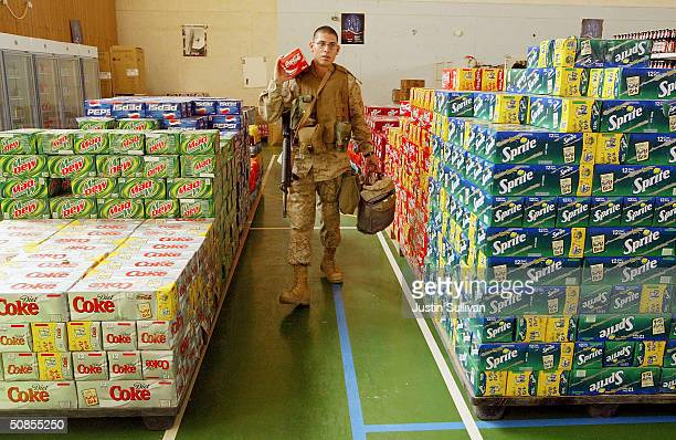 S Marines Lance Corporal Manuel Silva from the 2nd Battalion 7th Marines shops for soft drinks at the base exchange on May 19 2004 at the Al Asad...