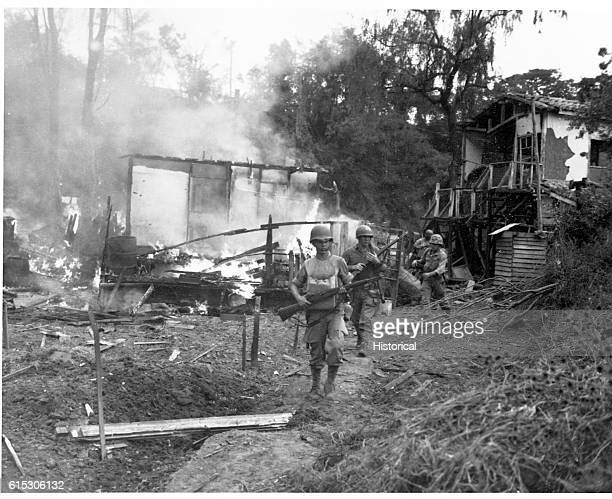 Marines lead patrol between destroyed buildings of a village in the 'mopup' of Wolmi Island after battle Wolmi Island is the gateway to Inchon Korea...