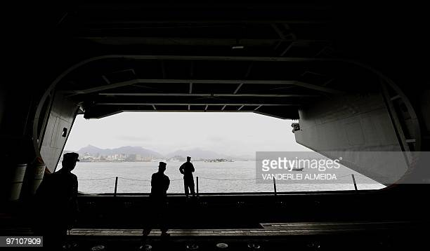 US marines look at rhe city from the USS Carl Vinson Nimitz class aircraft supercarrier at anchor in Guanabara Bay Rio de Janeiro Brazil on February...