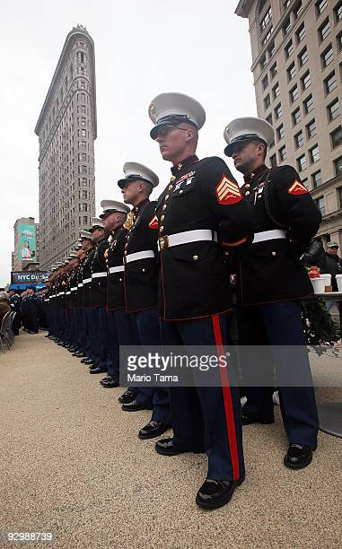 S Marines look on before the annual Veterans Day parade November 11 2009 in New York City The nation's largest Veterans Day parade featuring 20000...