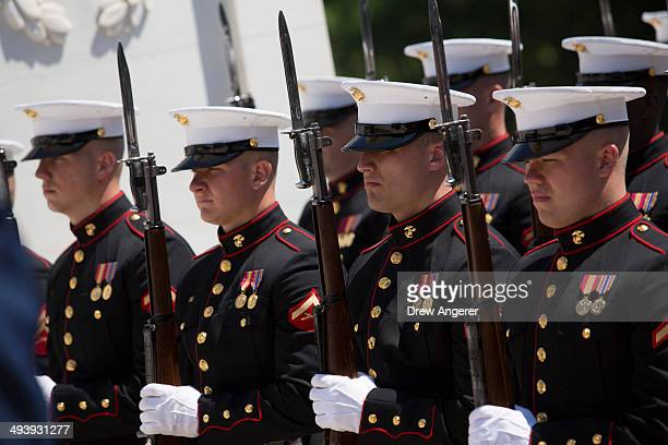 S Marines look on during a wreath laying ceremony with President Barack Obama at the Tomb of the Unknown Soldier at Arlington National Cemetery May...