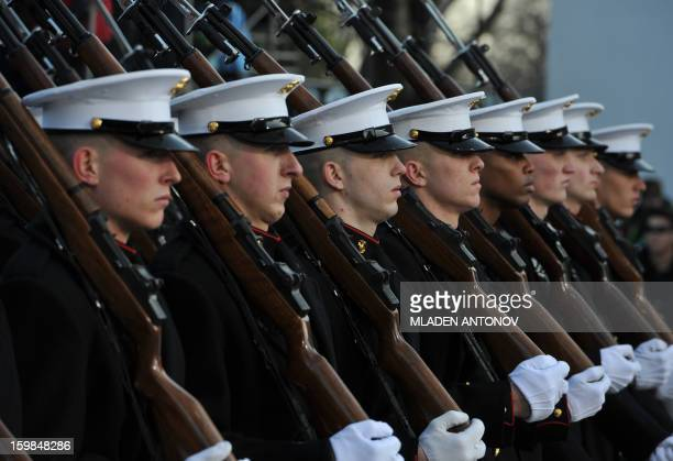 US Marines march as US President Barack Obama and First Lady Michelle Obama walk along Pennsylvania Avenue during the parade following Obama's second...
