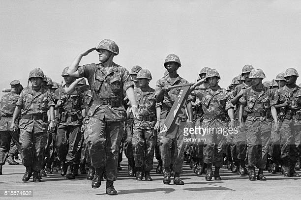 US Marines march in review in a ceremony April 14 which marked according to one of their generals 'the end of an era' in Vietnam The US Marine force...