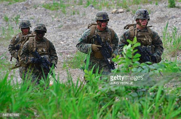 US Marines move to a position during a joint military drill between US and South Korean Marines at a fire training field in the southeastern port of...