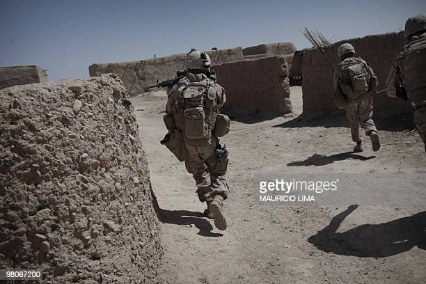 Marines of 3rd Battalion, 6th Marines, India Company, move towards Taliban position as their squad came under heavy fire while conducting a joint...