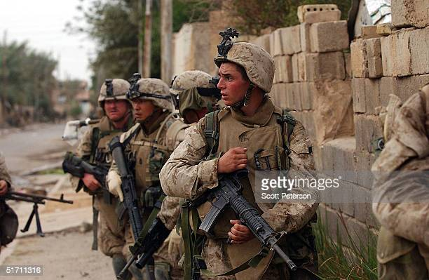 S Marines of Bravo Company 1st Battalion 3rd Marines make their final attack completing a push from north to south to the main road that divides the...