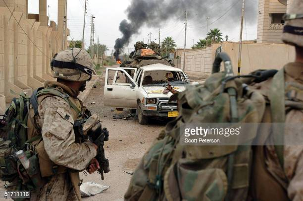 Marines of Bravo Company 1st Battalion 3rd Marines try to clear a street November 9 2004 in Fallujah Iraq On the authority of Interim Prime Minister...