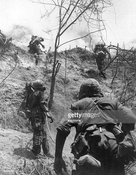 Marines of G Company 4th Marines are pictured climbing a hill in preparation for attack against the North Vietnamese