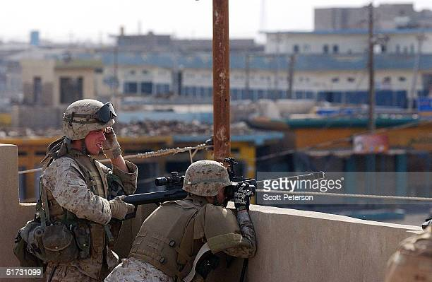 S Marines of the 1st Battalion 3rd Marines use a Sasr sniper rifle to take on an Iraqi insurgent counteroffensive in Fallujah to mark the Islamic...