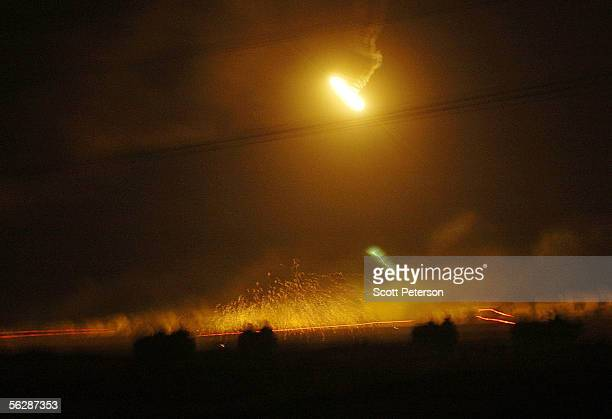 S Marines of the 1st Battalion 3rd Regiment break through the northern perimeter under the light from flares in a firefight November 8 2004 in...