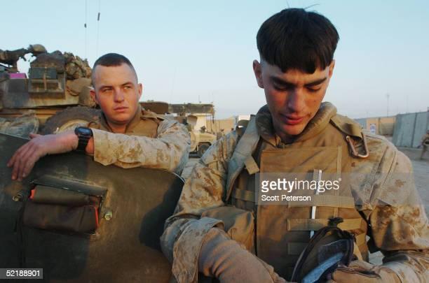 Marines of the 1st Light Armored Reconnaissance Charlie Company Raider Platoon LCpl Matt McClellan and LCpl Jeff Merbs prepare for a final combat...