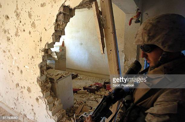 Marines of the 1st Light Armored Reconnaissance company as part of 1st Battalion 3rd Marines clear and search houses for insurgents one by one on...