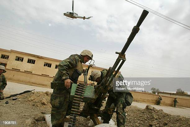 Marines of the 1st Marine Division outside the city of Tahrir prepare March 30, 2003 to destroy a 14.5 caliber Iraqi anti-aircraft gun in Tahrir,...