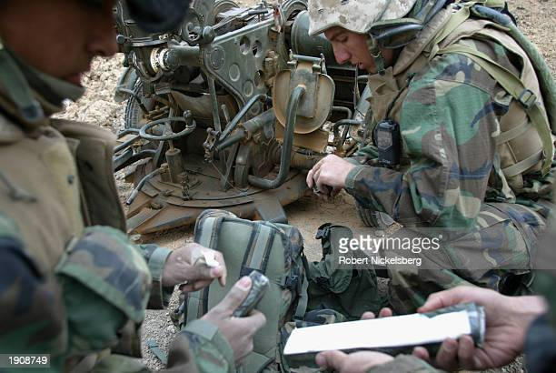 Marines of the 1st Marine Division prepare March 30, 2003 to destroy a 14.5 caliber Iraqi anti-aircraft gun with C-4 explosives March 30, 2003 in...
