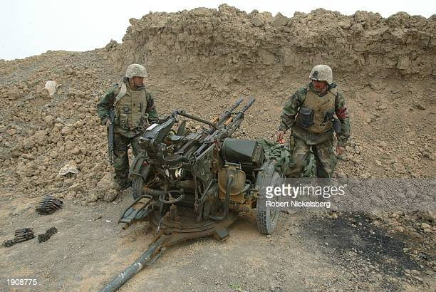 US Marines of the 1st Marine Division prepare March 30 2003 to destroy a 145 caliber Iraqi antiaircraft gun in Tahrir Iraq 100 km south of Baghdad...