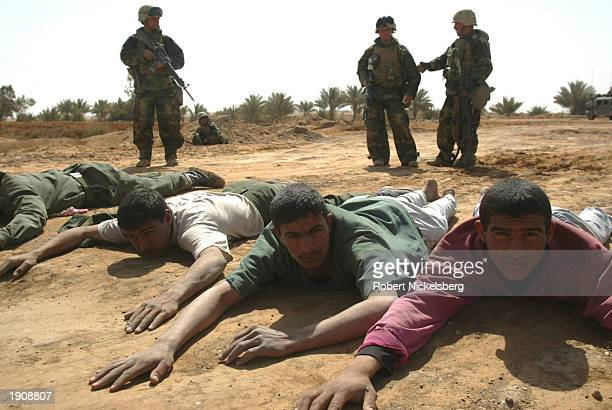 Marines of the 1st Marine Division secure 19 Iraqi Army POWs, some of whom surrendered, April 1, 2003 in Diwaniya, Iraq. Diwaniya, a city of 300,000...