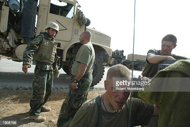 Marines of the 1st Marine Division wait by the side of the highway, 60 kms south of Baghdad, April 4, 2003 for the final push into the capital as...