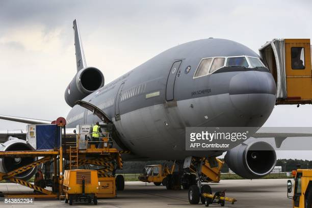 Marines of the Dutch Defence Armed Forces load a McDonnell Douglas KC10 with humanitarian aid for victims of the hurricane Irma on the island Saint...