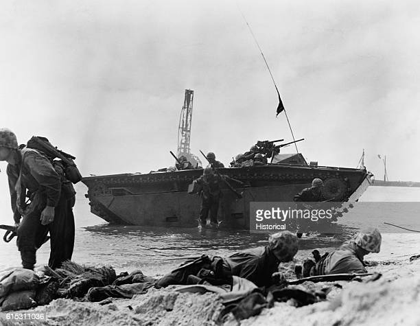 Marines of the Fourth Division come ashore under fire on Namur during the first land assault of the Marshall Islands attack during World War II